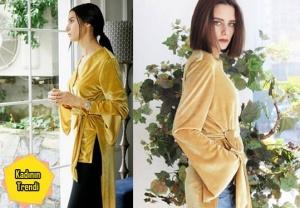 Paramparça dizisinin 87. Bölümünde, Candan karakterinin giydiği, sarı bluz Suuistanbul.