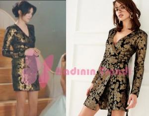 Melek'in giydiği altın rengi çiçek işlemeli siyah elbise Trendyol marka.