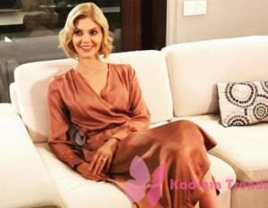 Dolunay 9. bölüm Alara Bozbey Demet karakterinin giydiği uzun turuncu saten elbise HM markadır