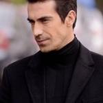 4. bölümde İbrahim Çelikkol siyah palto markası Network. Ferhat siyah triko kazak Que marka