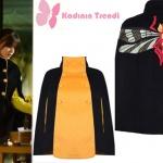 İstanbullu Gelinde Süreyya'nın giydiği sarı düğmeli siyah pelerin model mont Jaquette marka.
